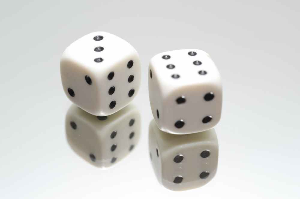 pair of white dice on top of mirror